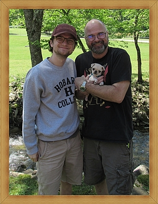Bella's Aramis aka Floyd with Jim and son - Multiple Color Pugs Puppies | A dog is one of the remaining reasons why some people can be persuaded to go for a walk.