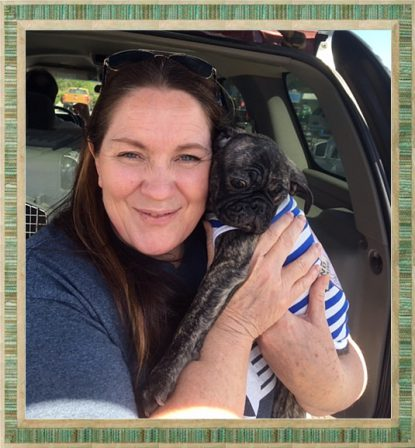 Arielle loves her new mom - Brindle Pug Puppies | I think we are drawn to dogs because they are the uninhibited creatures we might be if we weren't certain we knew better.