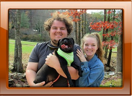 Brenna and her new family - Smiles all around! - Adult Black Pug | A dog will teach you unconditional love, if you can have that in your life, things won't be too bad.