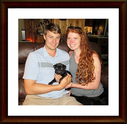 Bella's Edward with his new mom and dad - Black Pug Puppies | I think we are drawn to dogs because they are the uninhibited creatures we might be if we weren't certain we knew better.