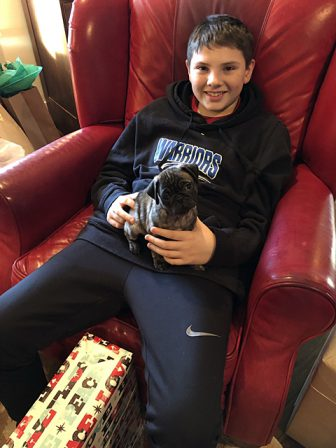 A boy and his pug! - Brindle Pug Puppies | Outside of a dog, a book is man's best friend - inside of a dog it's too dark to read.