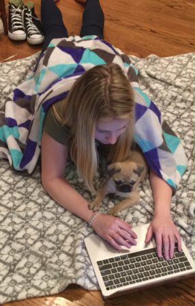 Puddin's Mushu/Dolly helping her fave person study for a math exam. - Fawn Pug Puppies | To sit with a dog on a hillside on a glorious afternoon is to be back in Eden.