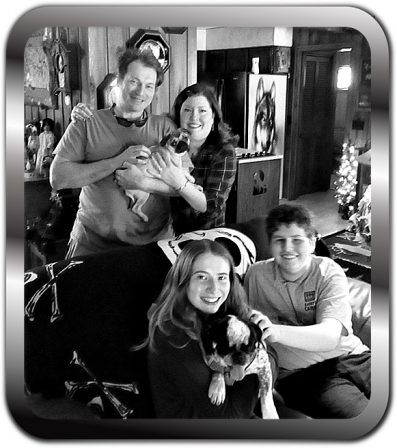 The Hubbell Family with Violet and Pennywise - Multiple Color Pugs Puppies | Even the tiniest dog is lionhearted, ready to do anything to defend home and family.
