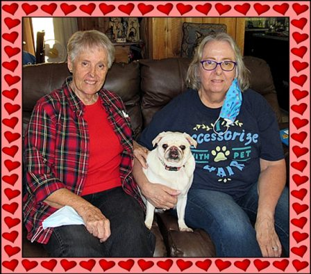 Marjorie and Cheryl with Snow - Adult White Pug | Outside of a dog, a book is man's best friend - inside of a dog it's too dark to read.