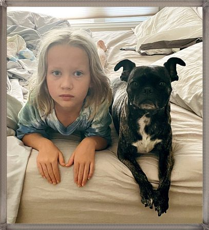 Tegan/Zoiee with her very own little girl - Adult Brindle Pug | The dog is a gentleman; I hope to go to his heaven not man's.